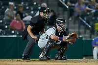 Winston-Salem Dash catcher Evan Skoug (19) sets a target as home plate umpire Jake Bruner looks on during the game against the Myrtle Beach Pelicans at TicketReturn.com Field on May 16, 2019 in Myrtle Beach, South Carolina. The Dash defeated the Pelicans 6-0. (Brian Westerholt/Four Seam Images)