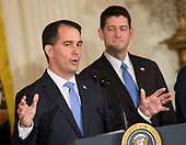 Governor Scott Walker (Republican of Wisconsin) makes remarks during the announcement of the creation of a Foxconn Factory to be built in Wisconsin to build LCD flat screen monitors at The White House in Washington, DC, July 26, 2017.  At right is the Speaker of the US House Paul Ryan (Republican of Wisconsin).<br /> Credit: Chris Kleponis / CNP