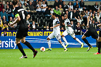 Thursday  03 October  2013  Pictured:Jonathan de Guzman of Swansea ( with ball ) takes the ball forward for the swans<br /> Re:UEFA Europa League, Swansea City FC vs FC St.Gallen,  at the Liberty Staduim Swansea