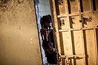 A mentally-ill Sub-Saharan illegal migrant in isolation in one of the Surman detention centers for illegal migrants on the west coast of Libya.