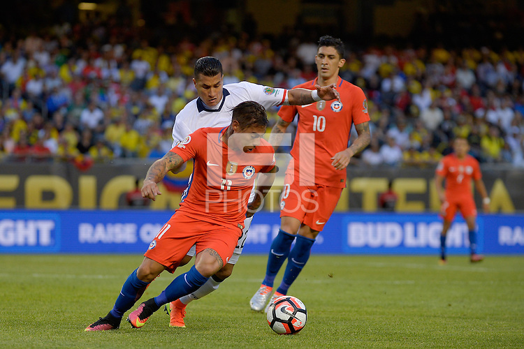 Chicago, IL - Wednesday June 22, 2016: Eduardo Vargas, Jeison Murillo during a Copa America Centenario semifinal match between Colombia (COL) and Chile (CHI) at Soldier Field.