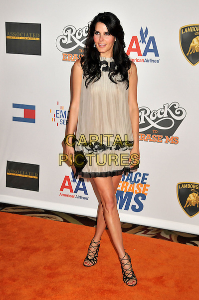 """ANGIE HARMON.16th Annual Race To Erase MS Themed """"Rock To Erase MS"""" held at the Hyatt Regency Century Plaza, Century City, CA, USA..May 8th, 2009.full length sleeveless dress clutch bag strappy sandals lace-up trim pleats pleated beige black .CAP/ADM/BP.©Byron Purvis/AdMedia/Capital Pictures."""