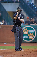 Home plate umpire Tanner Moore makes a strike call during the South Atlantic League game between the Hagerstown Suns and the Greensboro Grasshoppers at First National Bank Field on April 6, 2019 in Greensboro, North Carolina. The Suns defeated the Grasshoppers 6-5. (Brian Westerholt/Four Seam Images)