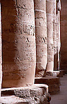 Columns in Karnak Temple in Luxor, Egypt with hieroglyphics illuminated by the sun.