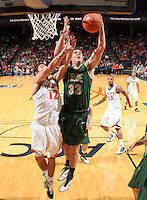 Nov. 12, 2010; Charlottesville, VA, USA;  William & Mary Tribe forward JohnMark Ludwick (33) grabs a rebound in front of Virginia Cavaliers guard Joe Harris (12) during the game at the John Paul Jones Arena. Virginia won 76-52.  Mandatory Credit: Andrew Shurtleff