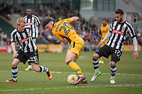 Tom Owen-Evans of Newport County attempts to get between Josh Clackstone and Jorge Grant of Notts County during the Sky Bet League 2 match between Newport County and Notts County at Rodney Parade, Newport, Wales on 6 May 2017. Photo by Mark  Hawkins / PRiME Media Images.