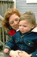 Mom holding son on lap age 40 and 3.  Minneapolis Minnesota USA