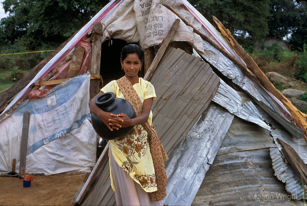 Families living in tarps after the tsunami in Sri Lanka.