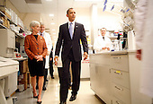 Bethesda, MD - September 30, 2009 -- United States President Barack Obama arrives with Secretary of Health and Human Services (HHS) Kathleen Sebelius (L)for a laboratory tour at the National Institute of Health (NIH) in Bethesda, Maryland, Wednesday, September 30, 2009. After the visit, President Obama will make a major announcement regarding the American Recovery and Reinvestment Act  at the National Institutes of Health..Credit: Aude Guerrucci / Pool via CNP