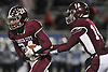 Trevor Yeboah-Kodie #24 of Garden City. left, takes a handoff from quarterback Colin Hart #14 during the Nassau County Conference II varsity football semifinals against Calhoun at Hofstra University on Friday, Nov. 10, 2017. Yeboah-Kodie ran four four touchdowns, including a 76-yard run in the third quarter, in Garden City's 35-14 win.