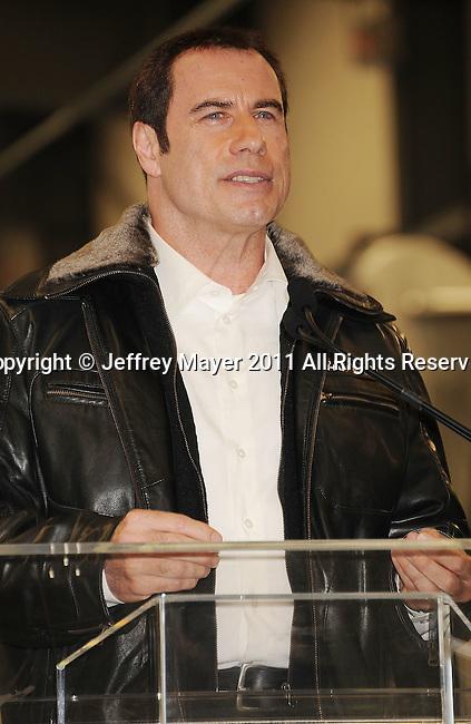 BURBANK, CA - SEPTEMBER 20: John Travolta and Brant Dahlfors attend the Bombardier business aircraft press conference at Hangar 25 at Burbank Airport on September 20, 2011 in Burbank, California.