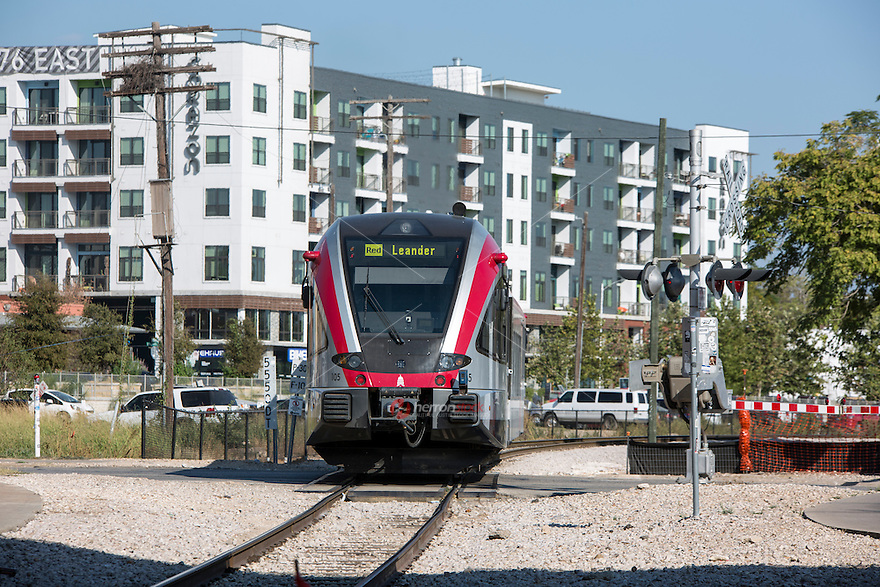 A MetroRail train makes its way along the newly built condos and apartments in the revitalized and booming East Austin