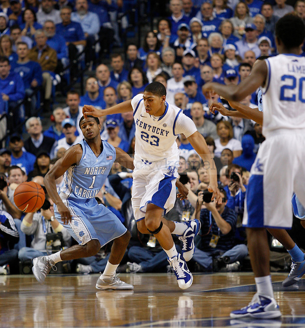 Anthony Davis and Dexter Strickland go for the ball in the first half of the game between the University of Kentucky and the University of North Carolina at Rupp Arena in Lexington, Ky., on Saturday, Dec. 3, 2011. Photo by Latara Appleby | Staff ..