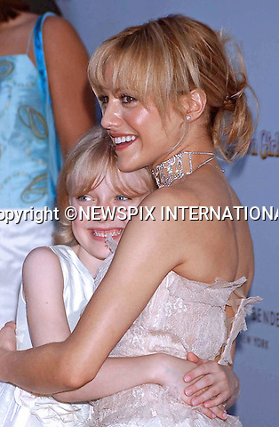 "BRITTANY MURPHY.has died following a cardiac arrest..The 32-year-old actress' mother discovered her unconscious in the shower in the house belonging to Murphy's husband, Simon Monjack..The website says that when paramedics arrived, they quickly determined Murphy was in full cardiac arrest and immediately administered CPR..They continued CPR en route to Cedars-Sinai Medical Centre. Murphy was pronounced dead on arrival at the hospital..LA County Coroner's Office is expected to launch an investigation...Brittany Murphy AND Dakota Fanning.""Uptown Girl"" Premiere, United Artist Southampton Theatre, New York City_08/09/2003.©KB-IP/NEWSPIX INTERNATIONAL.Mandatory credit photo:NEWSPIX INTERNATIONAL(Failure to credit will incur a surcharge of 100% of reproduction fees)..**ALL FEES PAYABLE TO: ""NEWSPIX INTERNATIONAL""**..Newspix International, 31 Chinnery Hill, Bishop's Stortford, ENGLAND CM23 3PS.Tel: +441279 324672.Fax: +441279 656877.Mobile: +447775681153.e-mail: info@newspixinternational.co.uk"