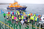 Some of the cyclists who cycled from Kells to Valentia in aid of the Valentia Lifeboat & the RNLI, pictured here on the Valentia Island Car Ferry on Sunday with the Valentia Lifeboat giving escort.