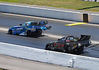 Jun 18, 2017; Bristol, TN, USA; NHRA funny car driver John Force (left) crosses lanes in front of Del Worsham during the Thunder Valley Nationals at Bristol Dragway. Mandatory Credit: Mark J. Rebilas-USA TODAY Sports