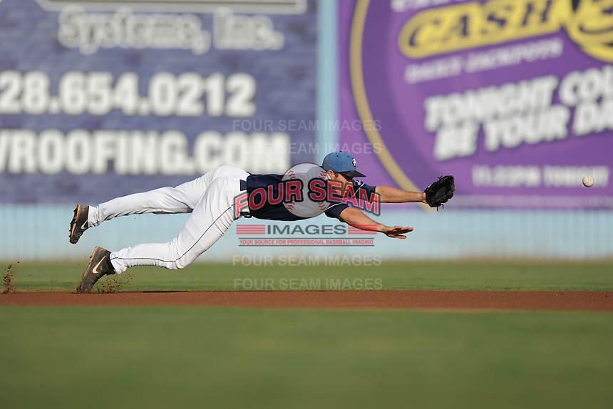 Asheville Tourists shortstop Jason Stolz #11 dives for a ball during a game against the August GreenJackets at McCormick Field on August 31, 2013 in Asheville, North Carolina. The Tourists won the game 6-5. (Tony Farlow/Four Seam Images)