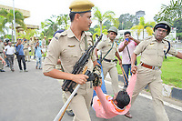 Pictured: A Congress activist is removed by force by police officers.<br /> Re: Activists of the Congress political party clash with police in protest against price rises in oil, gas and other daily commmodities by BJP government in Agartala, in the Tripura area of India. Monday 10 September 2018