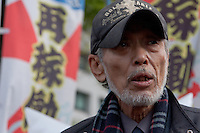 "Taro Fuchigami talks about his meeting with METI officials at the Occupy Kasumigasaki camp outside the METI building in Kasumigaseki, Tokyo, Japan. Friday April 12th 2013. The camp has been in place since September 2011 resisting several attempts to remove it. It now faces a court order restricting access and protestors have been served with a order to pay ""rent"" for their use of the land."