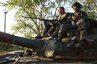 Ukrainian Army soldiers atop tank in Mariupol after battle with pro-Russian separatists. September, 2014