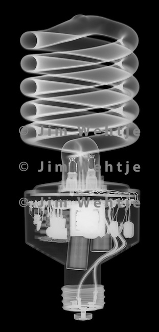 X-ray image of a compact fluorescent bulb (white on black) by Jim Wehtje, specialist in x-ray art and design images.