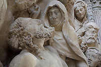 Detail from the Lamentation with the Virgin Mary mourning Jesus, high relief in stone, 1572, in the Collegiate Church of Saint-Gervais-Saint-Protais, built 12th to 16th centuries in Gothic and Renaissance styles, in Gisors, Eure, Haute-Normandie, France. The church was consecrated in 1119 by Calixtus II but the nave was rebuilt from 1160 after a fire. The church was listed as a historic monument in 1840. Picture by Manuel Cohen