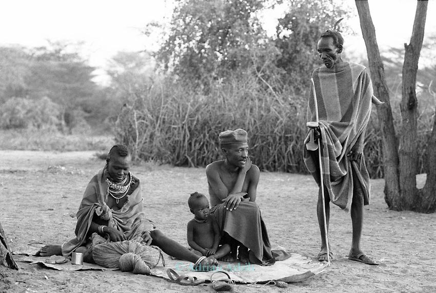 A Turkana family outside their family hut.<br /> Nr Kakuma. Northern Kenya.