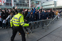 EDL protest and counter demonstration Slough, England 1-2-14 The far right English Defence League holds a national protest in Slough. Between 150-200 EDL supporters marched under heavy Police protection. A much larger counter demostration called by Unite Against Fascism, Slough Trades Council and ANTIFA  was attended by a large contingent of local youth and blocked the route of the EDL march and scuffled with Police. EDL supporters kick over a barrier.