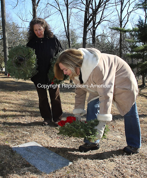 Washington, CT-121308MK10 Members of the  Judea Chapter of the Daughters of the American Revolution Victoria Cheruiske places a wreath on the grave of a World War II veteran as Cindy Brissett looks on at the Judea Cemetery in Washington Saturday. The local chapter along with students from Devereux Glenholme placed wreaths, which were made locally by Painter Ridge Farm, on each of the headstones of veterans that are laid to rest in the cemetery.  The event was timed in conjunction with the date and time that volunteers across America recognized those that have served the nation.    Michael Kabelka / Republican