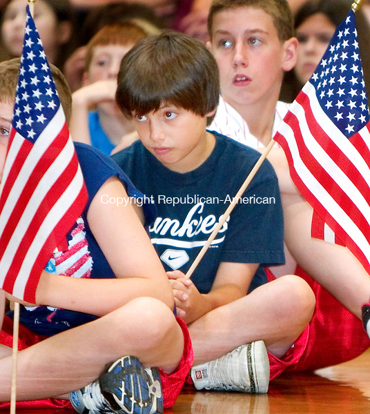 TORRINGTON, CT. 15 June 2010-061510SV05--Nick Dallavalle, 11, listens to vets talk about the flag during Flag Day ceremonies at East Elementary School in Torrington Monday. Dallavalle was one of the 5th grade flag holders to honor the vets.<br /> Steven Valenti Republican-American