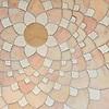 Ever Expanding Lotus, a waterjet stone mosaic, shown in honed Ivory Cream, Rosa Portagallo, Jerusalem Gold.