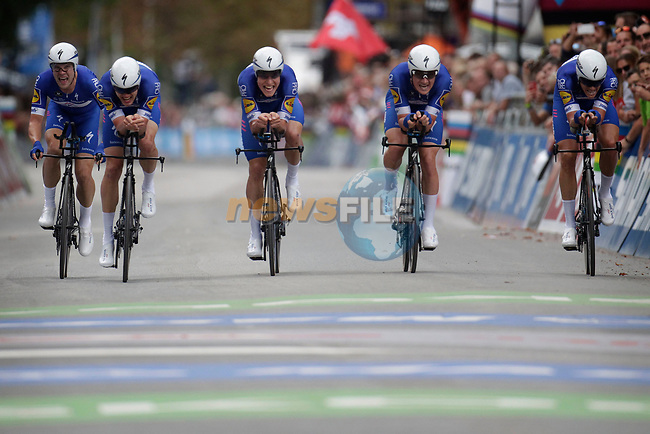 Quick-Step Floors cross the finish line to win the Men's Elite Team Time Trial of the 2018 UCI Road World Championships running 62.8km from Ötztal to Innsbruck, Innsbruck-Tirol, Austria 2018. 23rd September 2018.<br /> Picture: Innsbruck-Tirol 2018/BettiniPhoto | Cyclefile<br /> <br /> <br /> All photos usage must carry mandatory copyright credit (© Cyclefile | Innsbruck-Tirol 2018/BettiniPhoto)