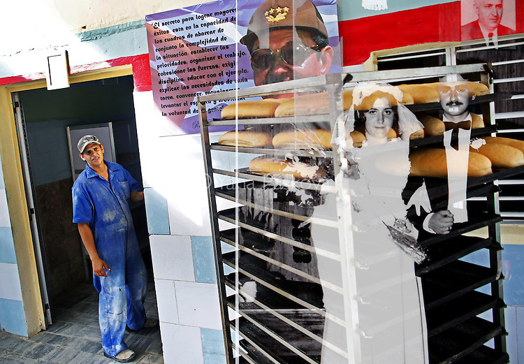 A bakery features a portrait of current president of Cuba Raul Castro in the port city of Mariel, Cuba, in April of 2015 - and a married couple poses for a picture under a portrait of former Bulgarian Communist dictator Todor Zhivkov. Zhivkov was the totalitarian head of state of the People's Republic of Bulgaria from March 4, 1954 until the day after the fall of the Berlin Wall, November 10, 1989, when he resigned under political pressure over the country's worsening economy and public unrest. <br />