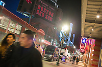 People walk along Lansdowne Street near the House of Blues and Fenway Park in the Fenway neighborhood of Boston, Massachusetts, USA, on Friday, Dec. 4, 2015. There are a number of bars and nightclubs in the area.