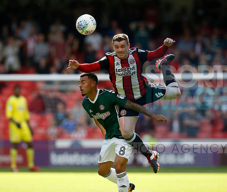 John Fleck of Sheffield Utd tussles with Nico Yennaris of Brentford during the English Championship League match at Bramall Lane Stadium, Sheffield. Picture date: August 5th 2017. Pic credit should read: Simon Bellis/Sportimage