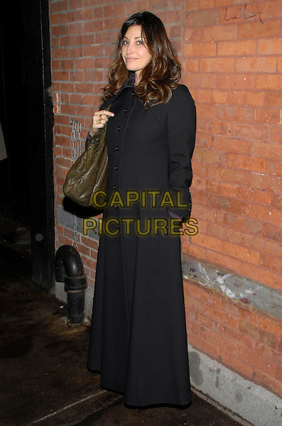 GINA GERSHON.The inagural benefit after party for the Adrienne Shelly Foundation held at Bar Martignetti, New York, New York, USA..November 12th, 2007.full length black long coat green leather bag hand in pocket .CAP/ADM/BL.©Bill Lyons/AdMedia/Capital Pictures. *** Local Caption ***
