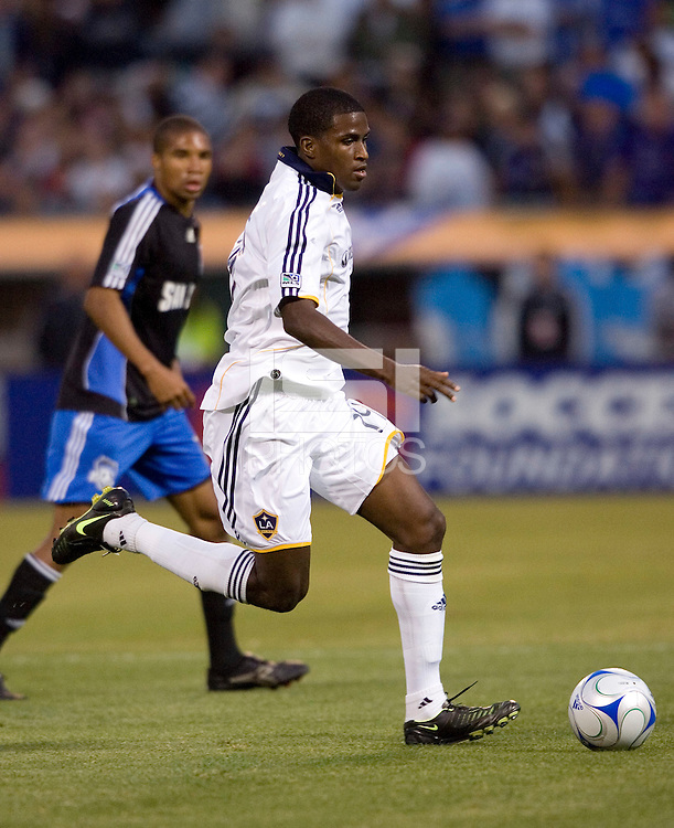 14 June 2008: Edson Buddle of the Galaxy dribbles the ball during the game against the Earthquakes at McAfee Coliseum in Oakland, California.   Los Angeles Galaxy defeated San Jose Earthquakes, 3-0.