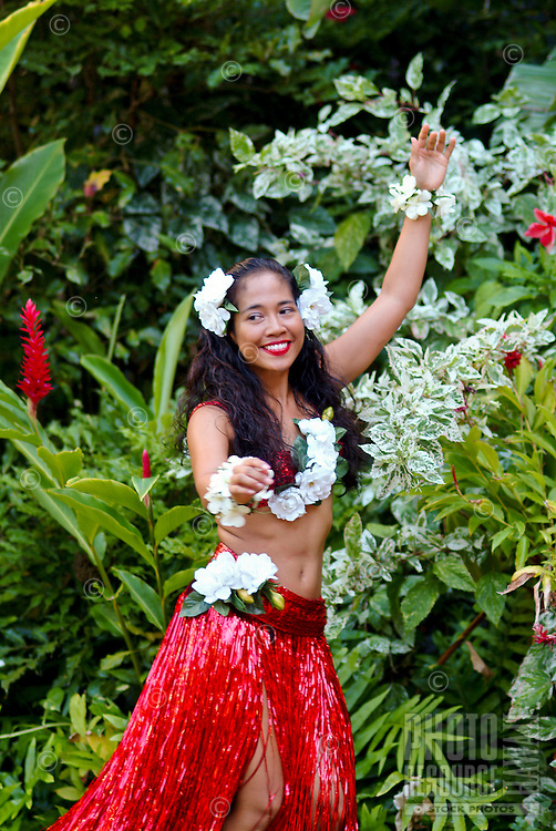 Hapa-Haole hula dancer preparing to dance at the Royal Hawaiian Hotel for the annual festival