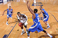 25 February 2010:  FIU's Marvin Roberts (11) looks for a way to the basket while being defended by MTSU's Desmond Yates (31), Calvin O'Neil (4) and James Washington (15) in the second half as the Middle Tennessee Blue Raiders defeated the FIU Golden Panthers, 74-71, at the U.S. Century Bank Arena in Miami, Florida.