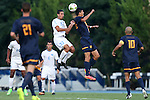 29 August 2014: North Carolina's Raby George (SWE) (33) and Cal's Stefano Bonomo (25) challenge or a header. The University of North Carolina Tar Heels hosted the University of California Bears at Fetzer Field in Chapel Hill, NC in a 2014 NCAA Division I Men's Soccer match. North Carolina won the game 3-1.
