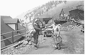 A north facing view of Ophir as seen from the road.  A 1930's unemployed &quot;Rambler&quot; is receiving a beer and sandwich from two Ophir ladies.<br /> RGS  Ophir, CO  ca 1930