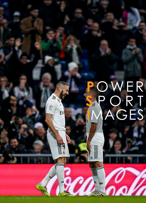 Karim Benzema of Real Madrid celebrates scoring the goal with teammate Lucas Vazquez during the La Liga 2018-19 match between Real Madrid and Rayo Vallencano at Estadio Santiago Bernabeu on December 15 2018 in Madrid, Spain. Photo by Diego Souto / Power Sport Images
