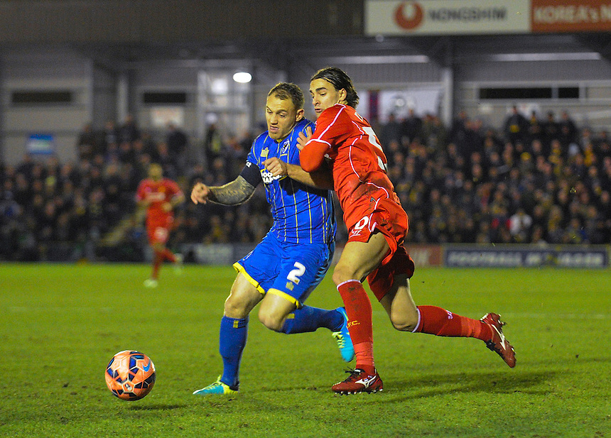 AFC Wimbledon's Barry Fuller holds off the challenge from Liverpool's Lazar Markovic<br /> <br /> Photographer Ashley Western/CameraSport<br /> <br /> Football - FA Challenge Cup Third Round - AFC Wimbledon v Liverpool - Monday 5th January 2015 - The Cherry Red Records Fans' Stadium - London<br /> <br />  &copy; CameraSport - 43 Linden Ave. Countesthorpe. Leicester. England. LE8 5PG - Tel: +44 (0) 116 277 4147 - admin@camerasport.com - www.camerasport.com