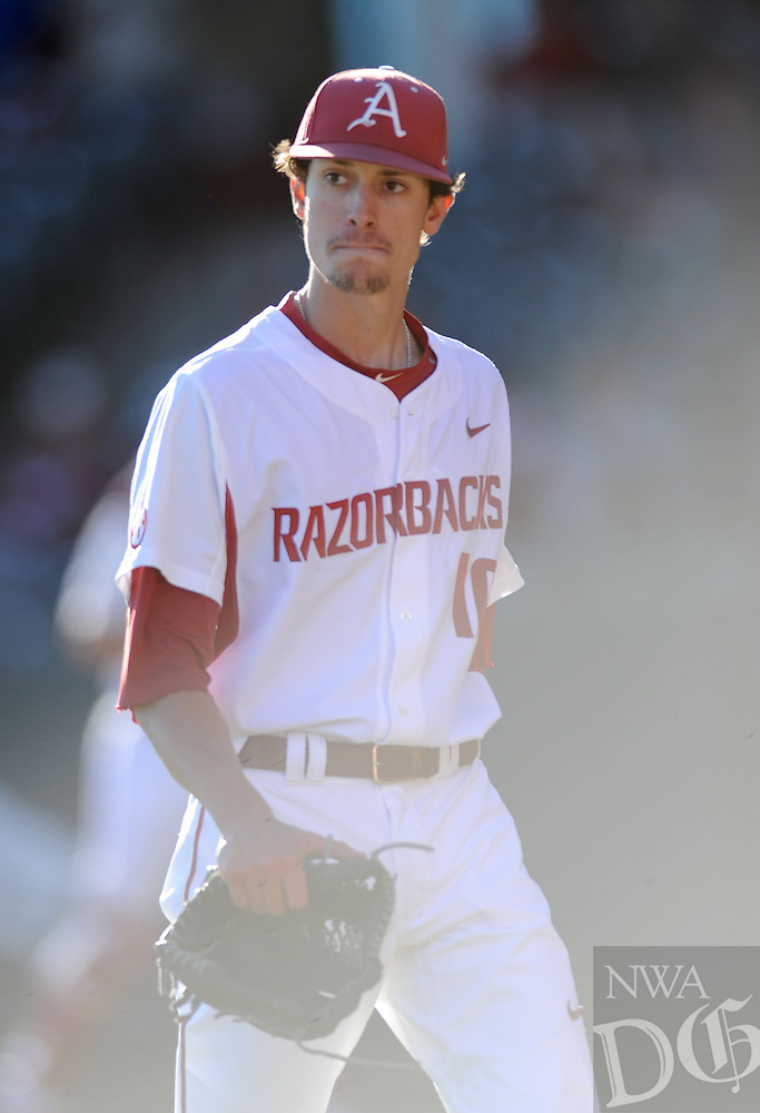 NWA Democrat-Gazette/ANDY SHUPE<br /> Arkansas starter Blaine Knight leaves the field after the final out of the fourth inning against Bryant Friday, Feb. 24, 2017, at Baum Stadium in Fayetteville. Visit nwadg.com/photos to see more photographs from the game.