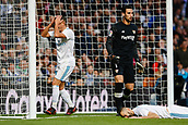 9th December 2017, Santiago Bernabeu, Madrid, Spain; La Liga football, Real Madrid versus Sevilla; Lucas Vaazquez Iglesias of Real Madrid Karim Benzema of Real Madrid, Sergio Rico of Sevilla FC, in action