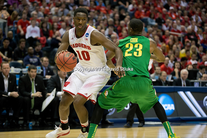 Wisconsin Badgers forward Nigel Hayes (10) handles the ball during the third-round game in the NCAA college basketball tournament against the Oregon Ducks Saturday, April 22, 2014 in Milwaukee. The Badgers won 85-77. (Photo by David Stluka)