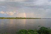 Altamira, Brazil. Frontier town on the Xingu river. Rainbow over the forest.
