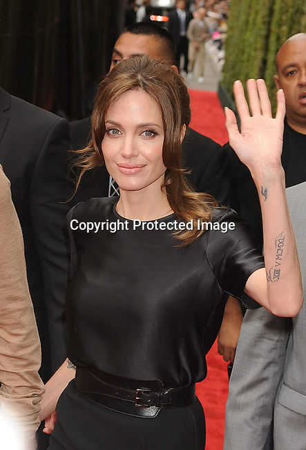 """HOLLYWOOD, {CA} -MAY 22: Angelina Jolie arrive at the Los Angeles premiere of """"Kung Fu Panda 2"""" held at Grauman's Chinese Theatre on May 22, 2011 in Hollywood, California."""