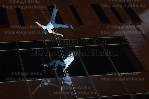Members of US dance company Bandaloop perform on the wall of Palace of Arts during the Budapest Spring Festival in Budapest, Hungary on April 6, 2019. ATTILA VOLGYI
