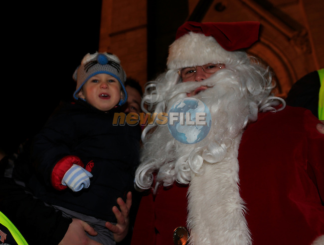 Anthony Ostass with Santa at the switching on of the christmas lights<br /> Picture: Fran Caffrey www.newsfile.ie